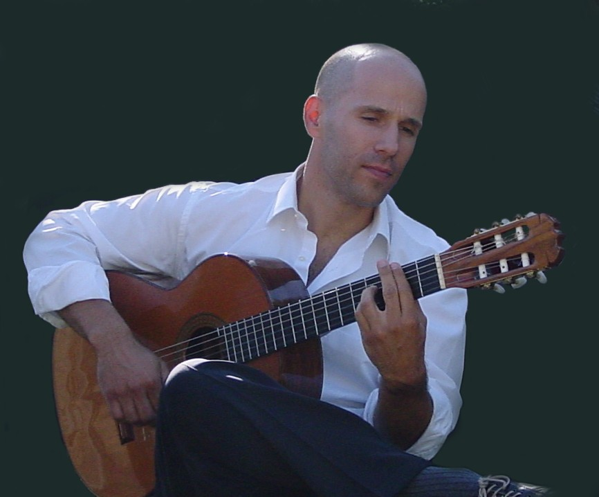 Photo of Alejandro Lazo playing guitar